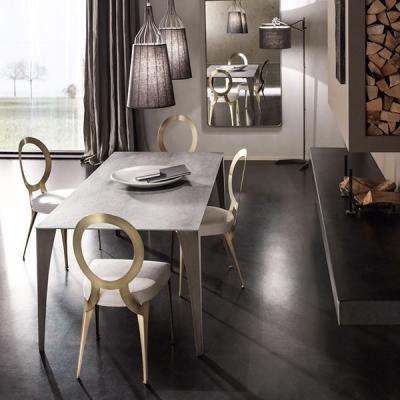 Стол за трапезария модел Miss - лазерно изрязана метална структура, текстилна или кожена тапицерия. Производител: Cantori, Итали